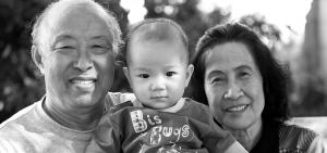 senior grandparents holding grandchild